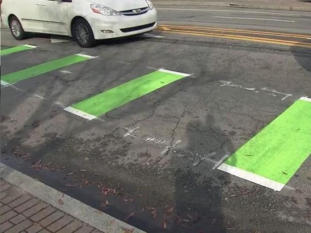On Hillsborough Street, green markings are part of a test program to make it a little safer for cyclists to transition out of bike lanes and into the main travel lanes.<br/>Photographer: Bill Herrero
