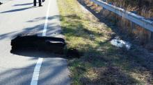 IMAGES: Chatham road closed by large sinkhole scheduled to reopen in July