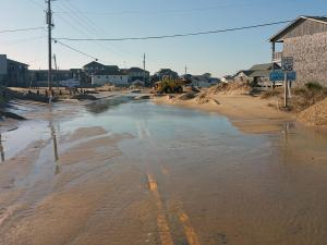 Ocean overwash and sand forced authorities to shut down parts of N.C. Highway 12 Monday morning in Dare County.