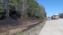 IMAGES: Firefighters extinguish brush fires along I-40 East