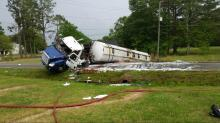 IMAGES: Driver charged after gas tanker overturns on NC 96