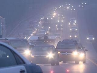 Interstate 540 at Glenwood Avenue is backed up Saturday as freezing rain causes slicked roads.
