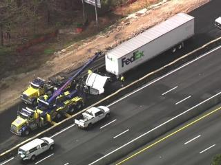Sky 5 flew over the scene of where a FedEx truck overturned Friday morning in Raleigh.