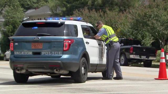 Raleigh police have closed a section of Glenwood Avenue from Peace Street north toward the Five Points neighborhood.