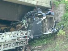 2 injured after car tumbles from bridge over I-40 near Southpoint