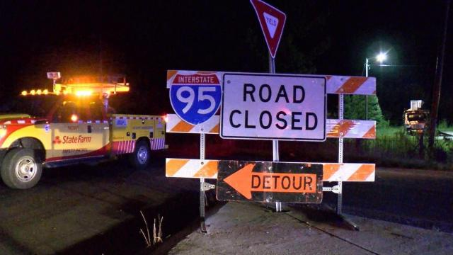 Part of Interstate 95 in Johnston County was closed late Wednesday night after a truck hauling an oversized load struck a bridge over the highway.