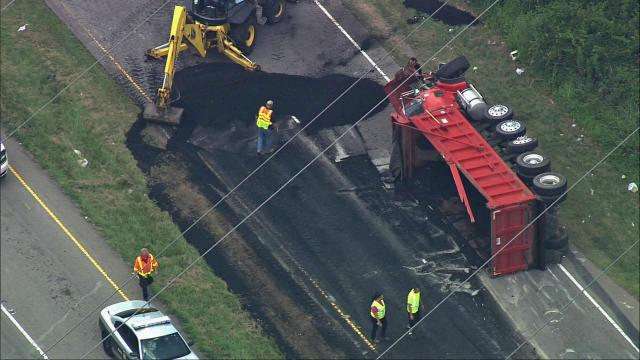 A truck carrying asphalt crashed, spilling its contents, near the intersection of U.S. 70 and Leesville Road