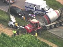 At least 1 person hospitalized after car, cement mixer collide in Fuquay-Varina