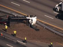 Overturned dump truck spills load, clogs I-40E near Cary
