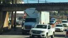 IMAGES: Tractor-trailer gets stuck under Peace Street bridge in Raleigh
