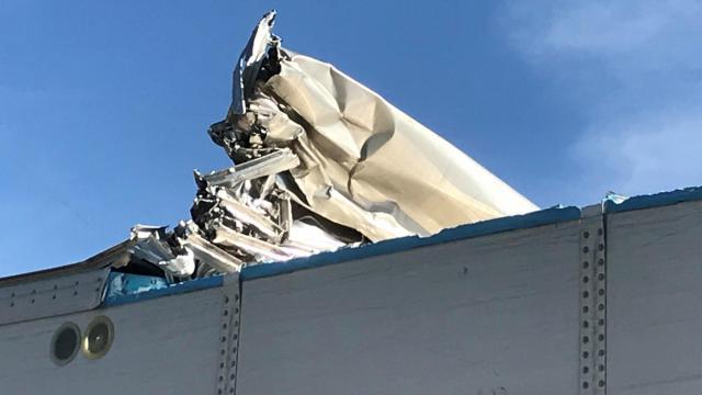 Tractor-trailer gets stuck under Peace Street bridge in Raleigh