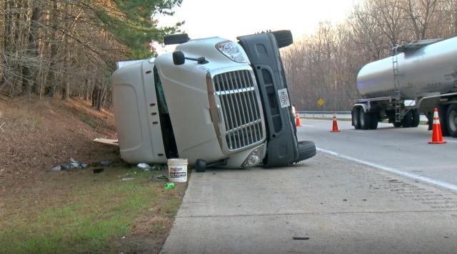 Truck flips, broken glass closes eastbound I-40 in Johnston