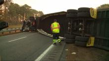 IMAGES: US 64 reopens after tractor trailer carrying UPS packages overturns