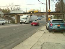 18-wheeler becomes lodged under Peace Street bridge