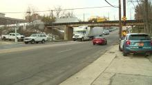 IMAGE: Not again: 18-wheeler becomes lodged under Peace Street bridge