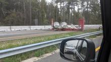 IMAGE: Traffic flowing on I-95 after containers of radioactive material dumped onto highway