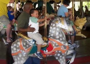 Photo by: Chastity Cheek. My son, Bailey riding the carousel at Pullen Park on Saturday, March 31, 07.
