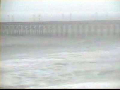 A massive storm off the North Carolina coast whipped up waves in Wilmington and the Outer Banks and blew in heavy rains into the central Carolina area.