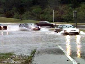 Crabtree Creek overflowed its banks onto a Raleigh roadway, making driving tough for motorists.