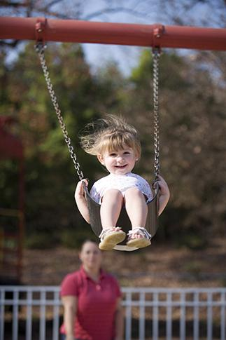 Olivia Brown, 2,  enjoys swinging with her mom, Daniella at Pullen Park on Tuesday.