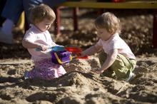 Twins Kellie and Kinzey enjoy playing in the sand together at Pullen Park in Raleigh on a unusually warm day in January.