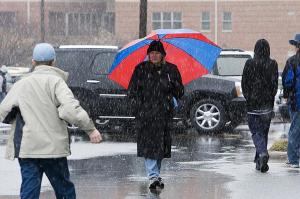 Fans head toward the Dean Smith Center in the snow before the Tar Heels game against Maryland on Saturday, January 19 at 3pm.