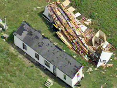 A tornado overturned this mobile home in Belgrade, in Onslow County, on Sunday, May 11, 2008.