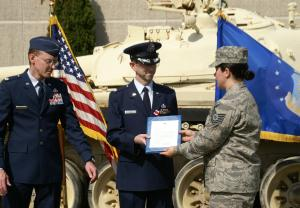 Receiving Air Force retirement orders from TSgt Ashleigh Pursell.
