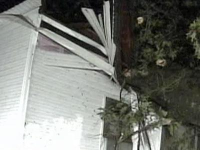 A house on Colon Road in Sanford was condemned after a huge tree fell on it Sunday, August 10, 2008.