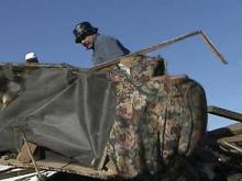 Tornado survivors sift through rubble