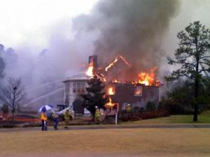 Firefighters battle a blaze at 1067 Canterbury Lane in Chapel Hill on Dec. 11, 2008. The homeowners said the fire was started by a lightning strike. (Submitted by Jon Cantrell)