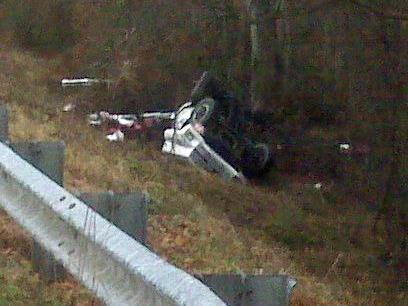 An icy bridge over the Tar River on Sims Bridge Road caused this truck to flip Friday morning, authorities said.