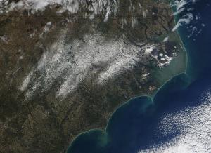 Terra/MODIS image of snow on the ground across NC on Thursday 22 Jan 09. Flipping back and forth between this and the previous image will give a sense of the rate of melting and of the streaks where snow was heaviest and most resistant to the melting process.