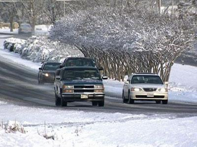 Cars travel along a Wilson County road on Feb. 4, 2009. Icy patches on some roads caused cars to skid.