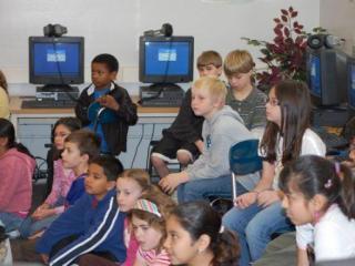 Washington ES school news elective students listen carefully (Courtesy: Lynn Lang)