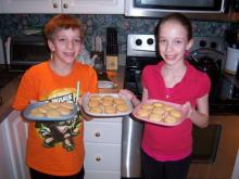 "Evan and Grace Vojnovich show off the cookies they baked while completing their winning project, ""Does the Cookie Sheet Make a Difference when Baking Cookies?"" from the Chesterbook Academy science fair. (Courtesy: Chesterbook Academy)"