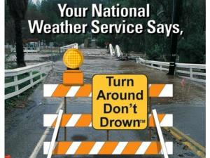 "A promotional poster from the National Weather Service's ""Turn Around, Don't Drown"" campaign."