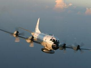 A NOAA WP-3 Orion hurricane hunter aircraft in flight. You can see one in person at RDU on Wednesday, May 6th or at the Wilmington airport on Thursday, May 7th.