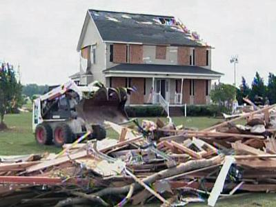 Residents in Wilson County began to clean up after severe weather damaged homes on March 5, 2009.
