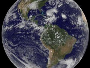 NOAA Satellite image from 3 Sep 2008 showing Gustav inland over te southern U.S. and Ike lurking over the south central Atlantic. Hanna is the large circulation nearing the Bahamas, and Josephine is the poorly organized system just west of Africa.