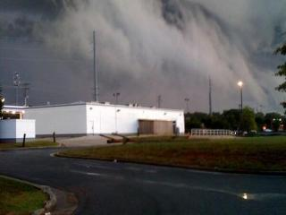 "Photo of an arcus ""shelf"" cloud along an apparent thunderstorm outflow boundary, with a curtain of rising fractus cloud just below and ahead of it."