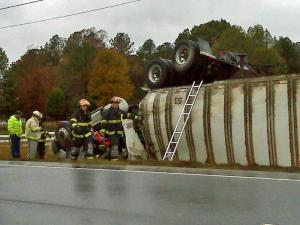 A truck overturned on an exit ramp from U.S. Highway 64 Business in Weldon on Thursday, Nov. 12, 2009.