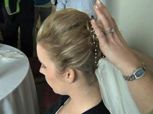 Raleigh bride Jane Bell gets her headpiece put in place before her wedding on Saturday, Jan. 30, 2010.