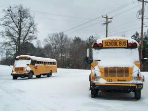 School buses sit covered in snow in Saxapahaw, North Carolina.