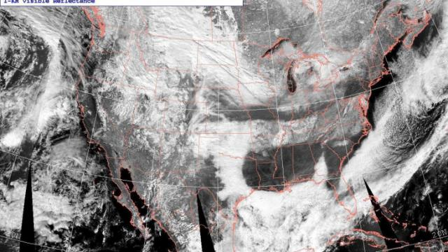 Aqua MODIS imagery showing snow and ice cover across the U.S., along with clouds, around midday on Sunday Jan 31, 2010.