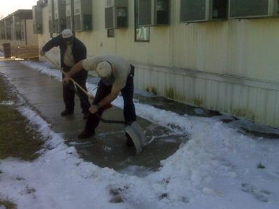 Workers shovel snow at Garner High School on Feb. 3, 2010.
