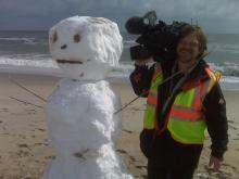 WRAL photographer Richard Adkins looks for an interview Saturday at Wrightsville Beach.
