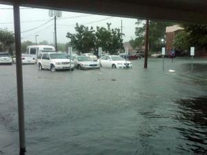 Heavy rains flooded the parking lot at the Robeson Digestive Clinic in Lumberton on July 27, 2010. (Photo by Dawn Clayton)