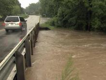 Heavy rain floods Little Creek in Clayton