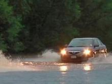 Wilmington residents wade through flood waters